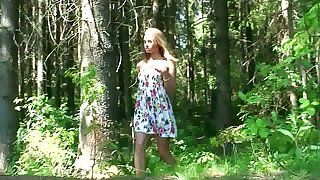 Lay skinny young chick squats down with the addition of pisses in the forest