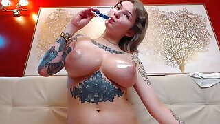 Amateur big tits MILF tattoed oiled boons unaffected by webcam