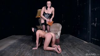 Lesbian femdom session with a strapon mistress anal pounding her slave