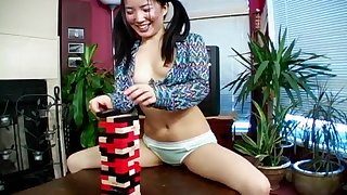 Asian teen with pigtails Almond reveals her pussy on the table