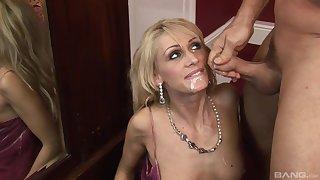 Skinny blonde mature MILF gets her face covered in semen