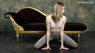 Russian gymnast Klara Lookova shows off yummy pussy and does dramatize expunge splits
